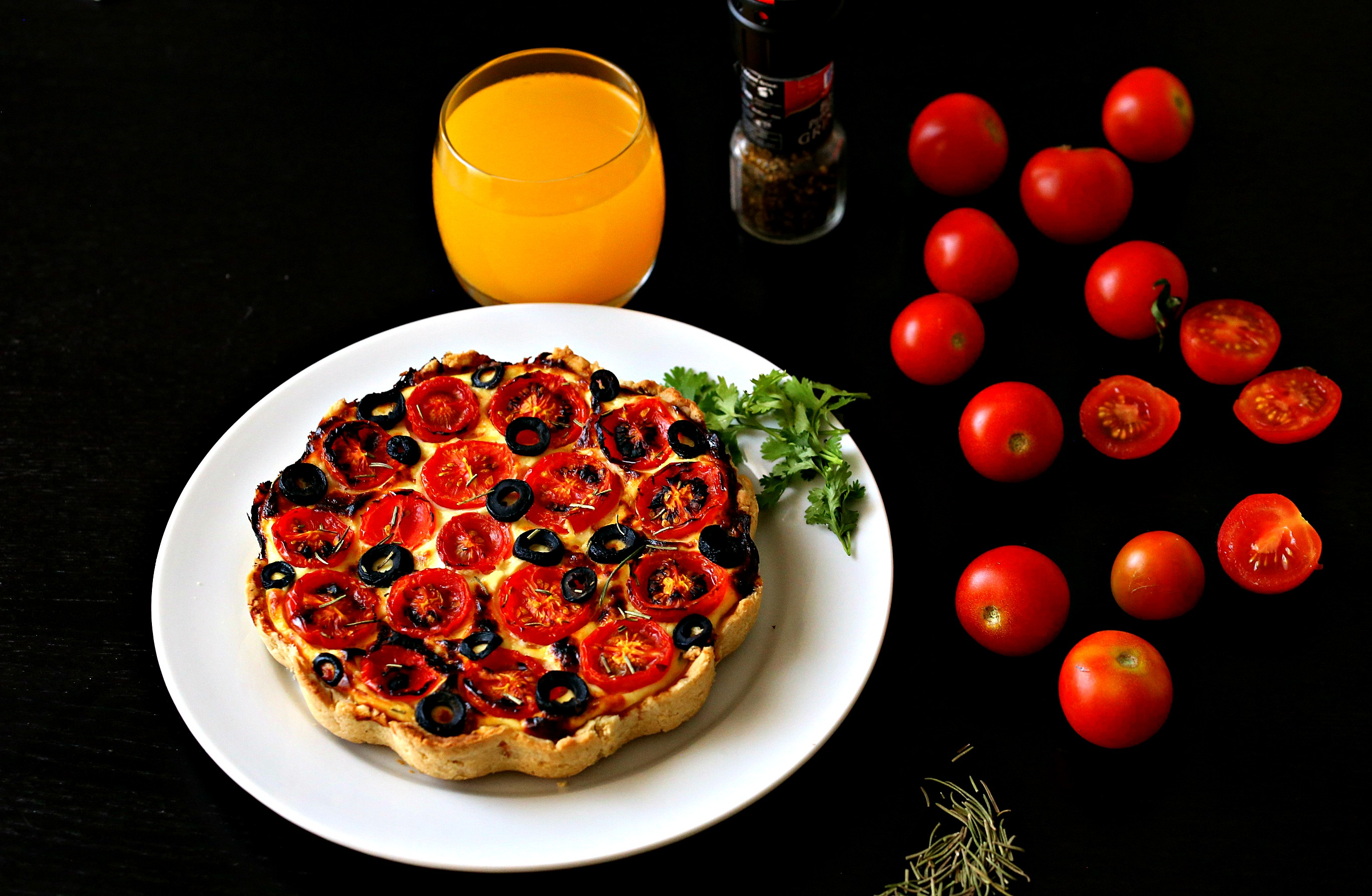 tomato tart with sharp flavors of black olive, rosemary and Parmesan ...