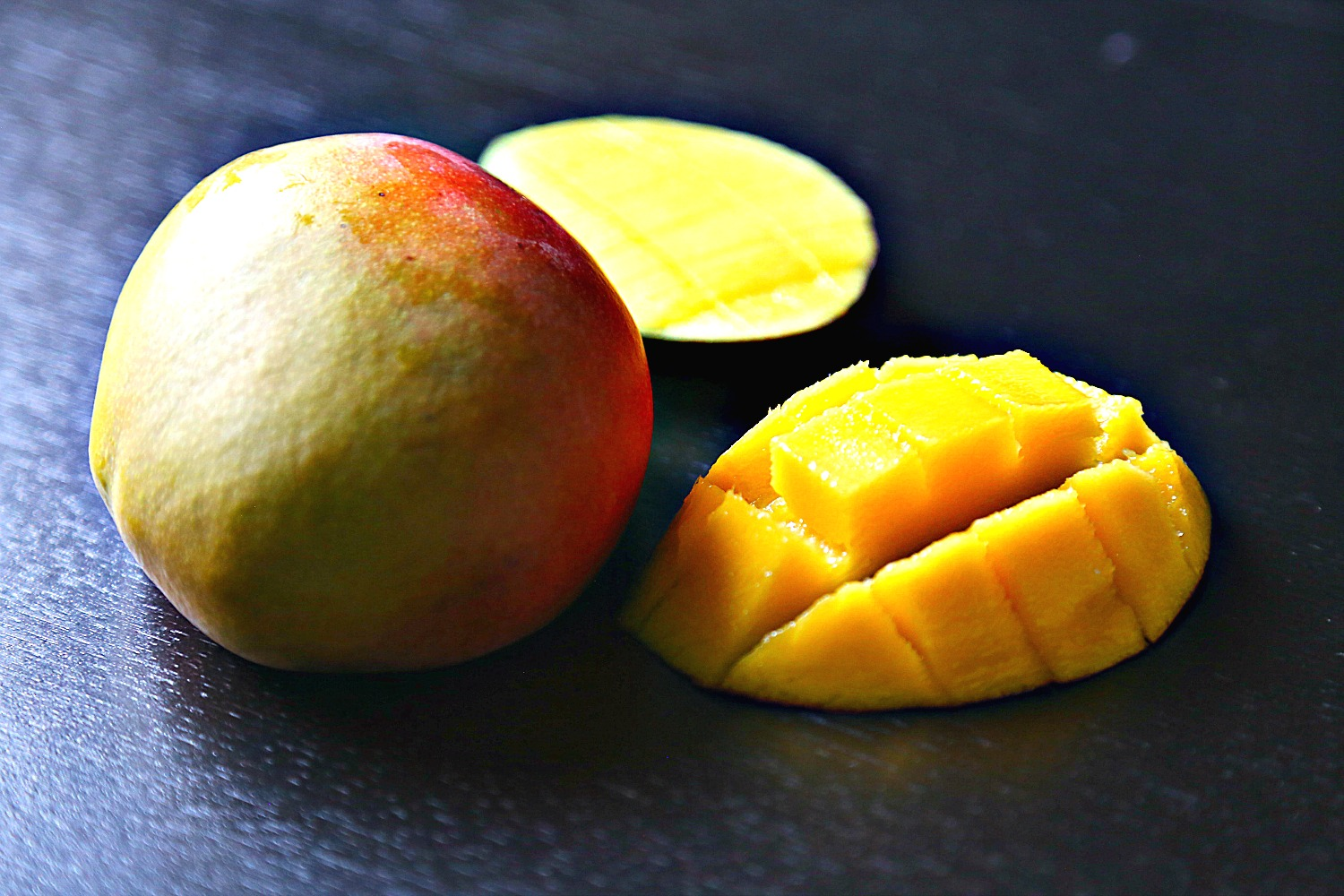 Mango fruit cut and whole